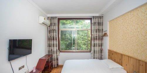 Забронировать Zhangjiajie Yijiaqin Hotel