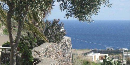 Забронировать Santorini Houses For Rent