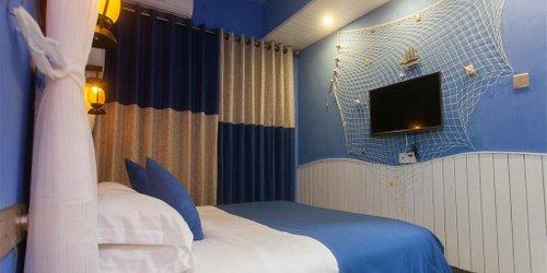 Забронировать Haikou Times Theme Inn