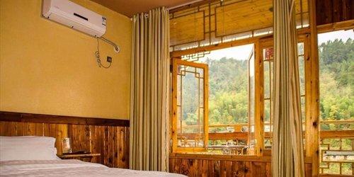 Забронировать Zhangjiajie Longquan Inn