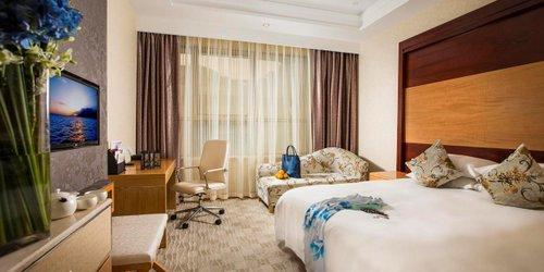Забронировать Huachen International Hotel