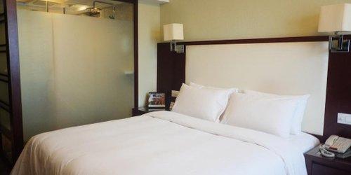 Забронировать Yiwu SSAW Huafeng Hotel