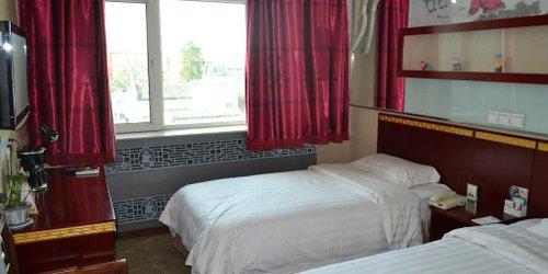 Забронировать Huguosi Hotel