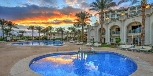 Забронировать Stella Di Mare Beach Hotel & Spa