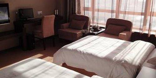 Забронировать Harbin Feilong International Business Hotel