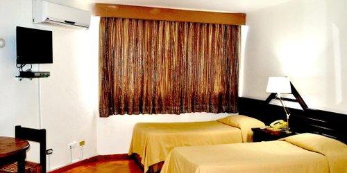Забронировать Aparta Hotel Plaza del Sol