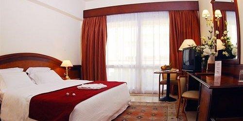 Забронировать Triumph Hotel & Conference Center
