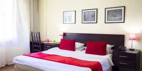 Забронировать NewCity Suites & Apartments