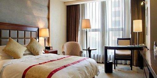 Забронировать Guidu Hotel Beijing
