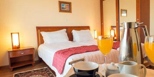 Забронировать Ambassador Hotel