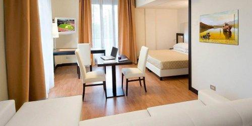 Забронировать Suite Hotel Elite