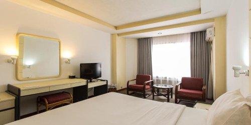 Забронировать The New Benakutai Hotel & Apartment