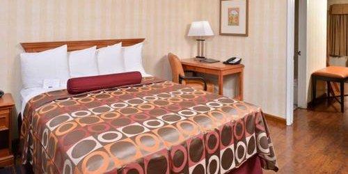 Забронировать BEST WESTERN PLUS Raffles Inn and Suites
