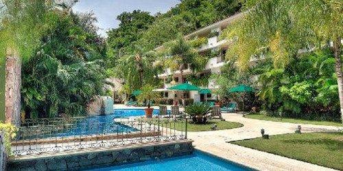 Забронировать Casa Iguana All Suites Hotel