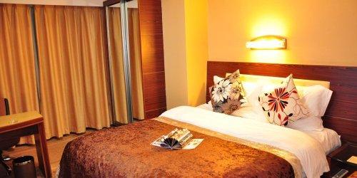 Забронировать Bremen Holiday Hotel Harbin