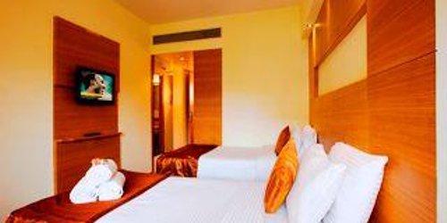 Забронировать Coral Tree Hotel