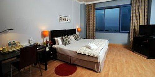 Забронировать Corniche Suites Hotel
