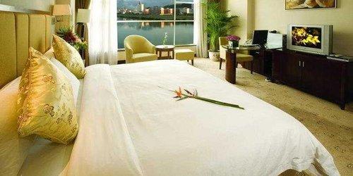 Забронировать Zhangjiajie Huaya Business Hotel