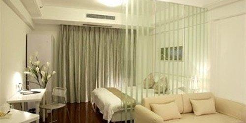 Забронировать Holiton International Business Hotel - Ningbo