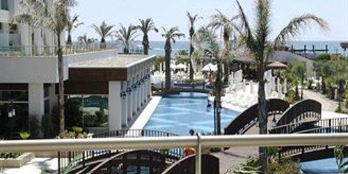 Забронировать Sunis Evren Beach Resort Hotel & Spa