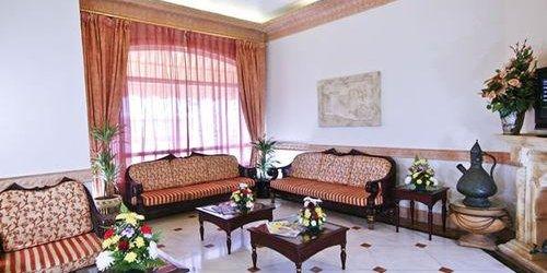 Забронировать Landmark Suites Hotel