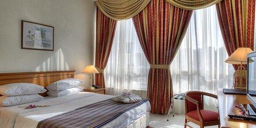 Забронировать Al Diar Palm Suites Hotel