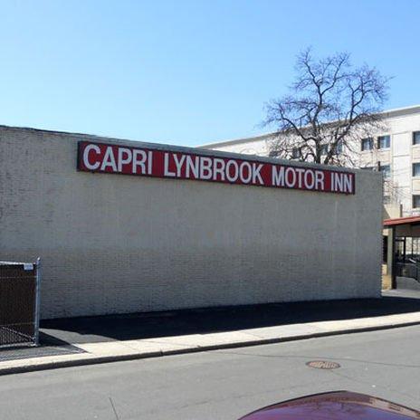 фото Capri Lynbrook Motor Inn 415533596