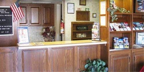 фото American Best Inn And Suites Mason City 668593114