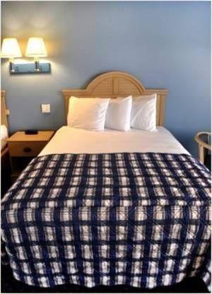 фото Coastal Palms Inn and Suites 677562372