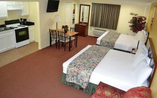 фото Executive Inn & Suites Magnolia 677679604