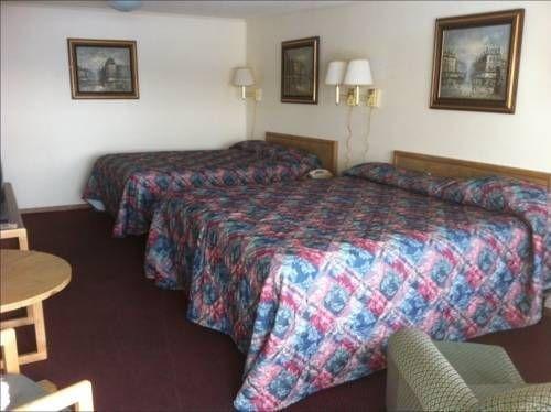 фото Passport Inn & Suites 677689666