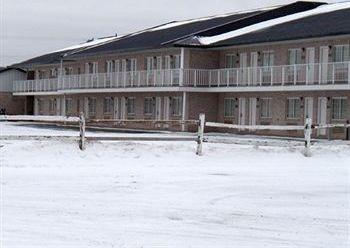 фото Magnuson Hotel Fowlerville 783409481